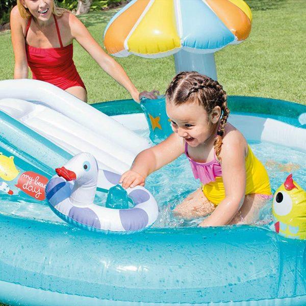 Little Girl Playing in Backyard Baby Pool